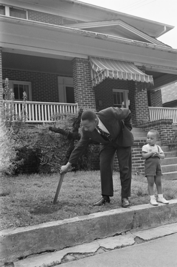 Martin Luther King Jr. Cleaning Scorched Earth Caused by the Ku Klux Clan