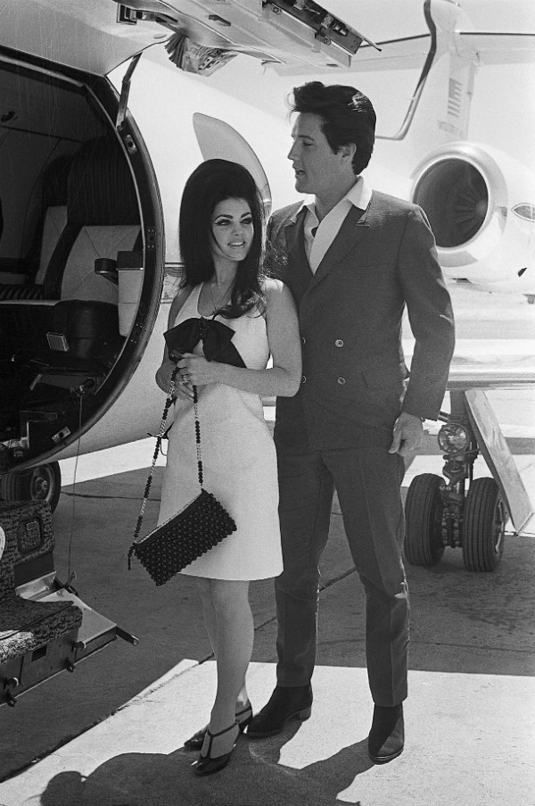 Elvis Presley and Priscilla Beaulie Board a Chartered Jet Airplane