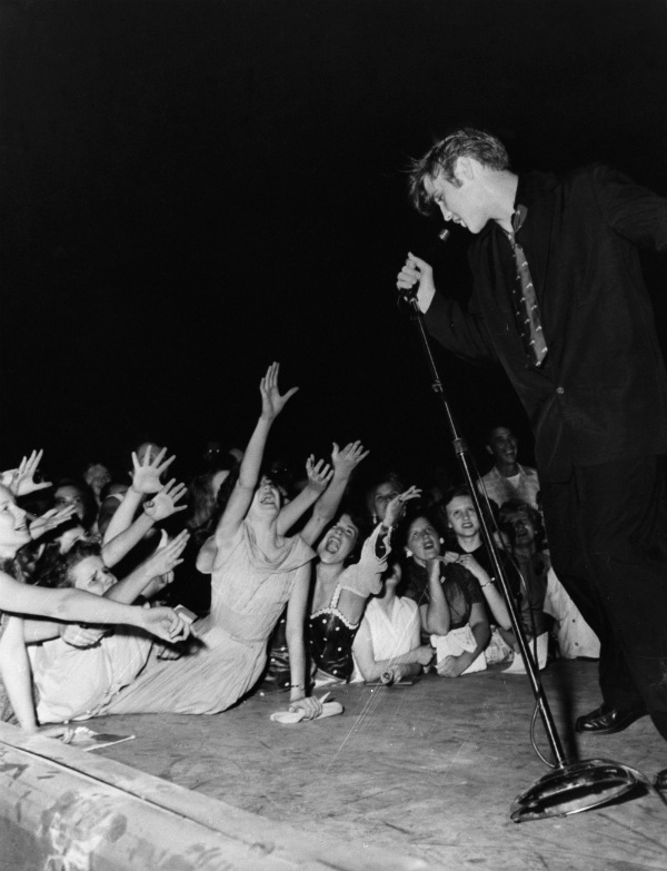 Elvis Presley Performs in Front of Screaming Teenage Fans