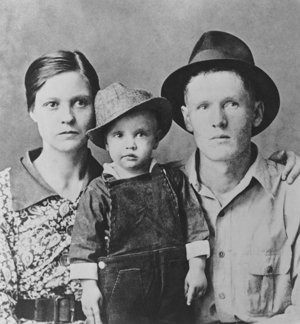 Elvis Presley with His Parents Vernon Presley and Gladys Presley in 1937 in Tupelo, Mississippi