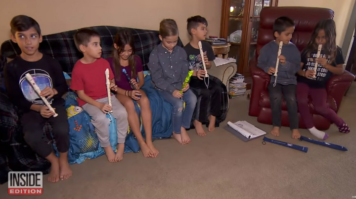 Octuplets Playing the Recorder