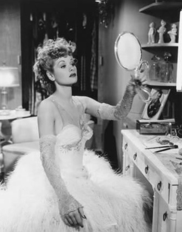 Lucille ball looking in a mirror